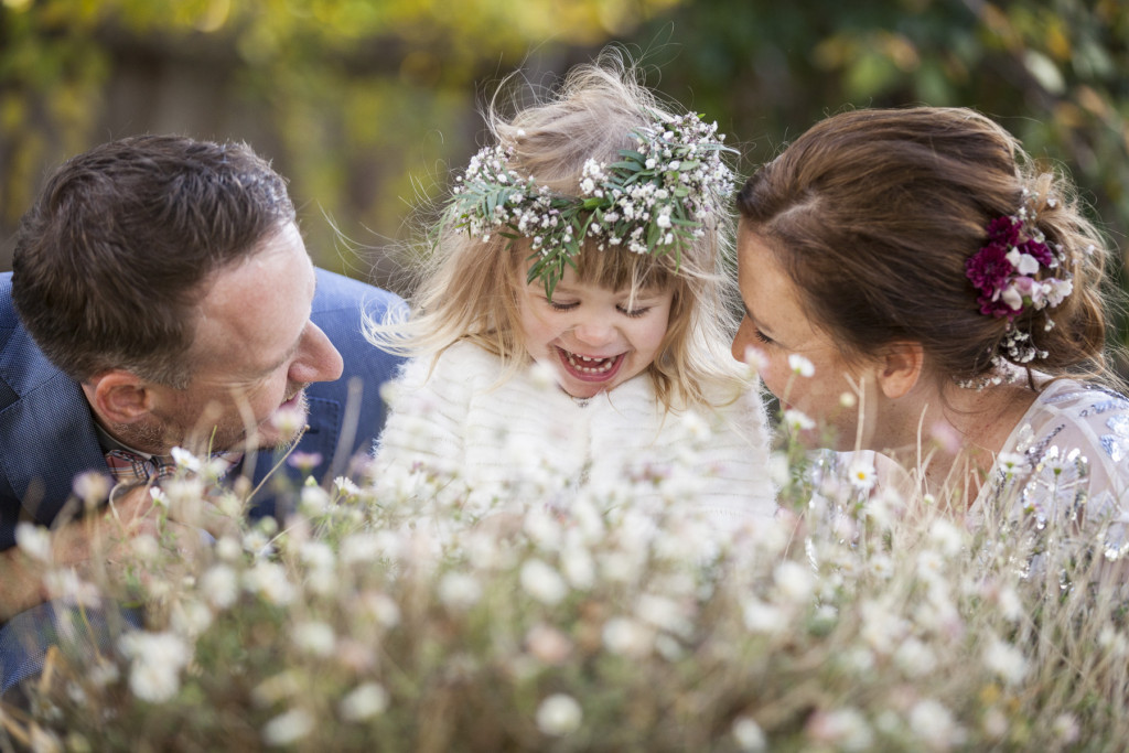 Following their wedding ceremony, Casey and Karl enjoying the Trentham Estate gardens with their daughter Lottie.